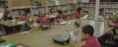 Student-Reading-in-School-Library - 915x368